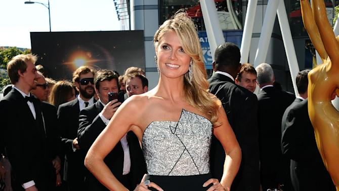 Heidi Klum arrives at the 2013 Primetime Creative Arts Emmy Awards, on Sunday, September 15, 2013 at Nokia Theatre L.A. Live, in Los Angeles, Calif. (Photo by Scott Kirkland/Invision for Academy of Television Arts & Sciences/AP Images)