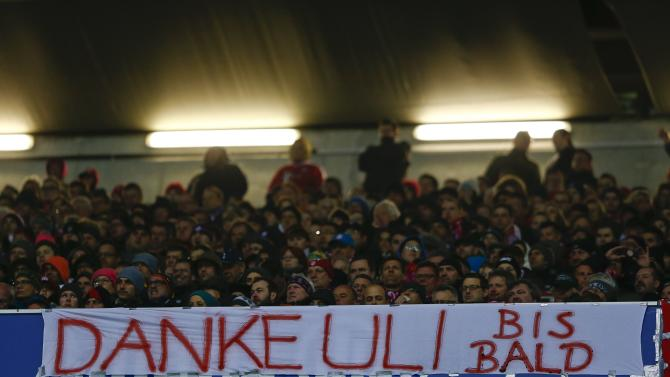 """Bayern supporters present a poster which reads """"Thank you Uli, see you soon"""" during the German first division Bundesliga soccer match between Bayern Munich and Leverkusen in Munich"""