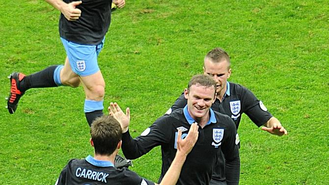 Wayne Rooney, centre, was on target as England recorded a draw in Poland