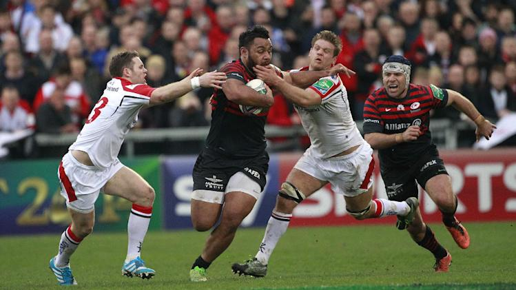 Saracens Billy Vunipola, centre, is tackled by Ulster's Darren Cave, left, and Chris Henry, right, during their Rugby Union European Cup Quarter- Final match at Ravenhill, Belfast, Northern Ireland, Saturday, April 5,  2014