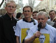 Oleg Shein (L) stands next to Just Russia party leader, Sergei Mironov (R) during a rally in the southern Russian city of Astrakhan