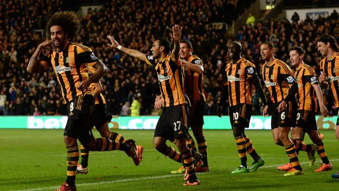 Hull City's Huddlestone celebrates scoring with Livermore against Fulham during their English Premier League soccer match in Hull