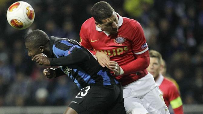 Netherlands PSV's Jeffrey Bruma, right, challenges for the ball against Franck Dja Djedje of  FC Chornomorets  during a Europa League Group B soccer match between FC Chornomorets and  PSV Eindhoven at the Chornomorets  stadium in Odessa, Ukraine, Thursday, Oct. 3, 2013