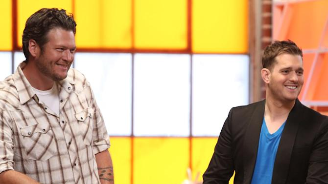 """Blake Shelton, left, and Michael Buble on the set of NBC's """"The Voice,"""" on Monday, July 9, 2012, in Los Angeles. Michael Buble will act as adviser to Blake Shelton's team of contestants on """"The Voice,"""" returning for its new season in September. (AP Photo/NBC, Tyler Golden)"""