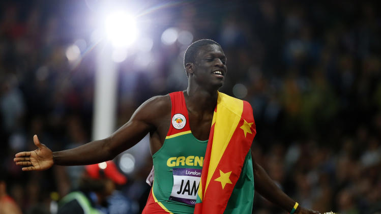 Grenada's Kirani James celebrates after winning the men's 400m final at the London 2012 Olympic Games at the Olympic Stadium