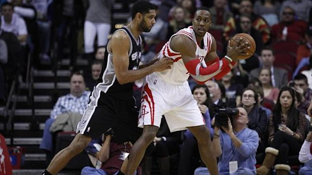 Houston Rockets center Dwight Howard (12) posts-up San Antonio Spurs power forward Tim Duncan (21) (Reuters)