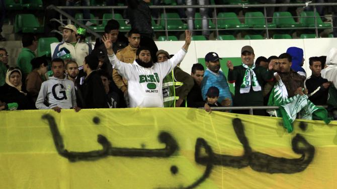 A fan of Morocco's Raja Casablanca gestures after the team won their FIFA Club World Cup soccer match against Mexico's Monterrey at extra time in Agadir