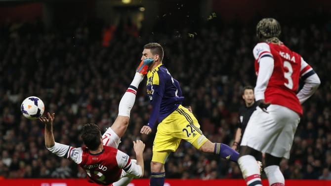 Arsenal's Giroud tries an overhead kick as he is challenged by Swansea City's Rangel during their English Premier League soccer match in London