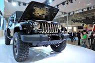 A Jeep model is displayed at the Auto China 2012 exhibition in Beijing on April 23. Automakers are rushing to cash in on China's growing passion for SUVs, with sales up five-fold in the last half-decade, as increasingly affluent urban consumers seek to showcase their wealth