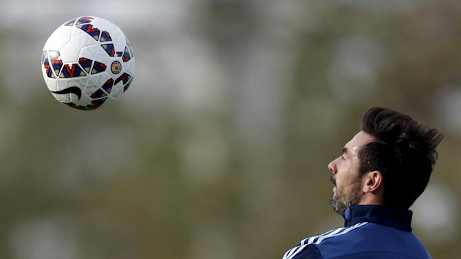 Argentina's Lavezzi controls the ball during a training session in Buenos Aires