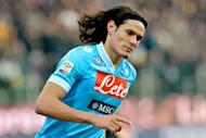 Napoli's Uruguayan striker Edinson Cavani celebrates after scoring against Parma during the Italian Serie A football match Parma vs. Napoli on January 27, 2013 at Parma's Tardini Comunal stadium. Cavani scored his 18th league goal of the season to take Napoli to within three points of Serie A leaders Juventus as Parma lost their unbeaten home record on Sunday