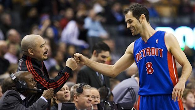 Detroit Pistons' Jose Calderon greets announcer Herbie Kuhn before his team plays the Toronto Raptors in Toronto (Reuters)