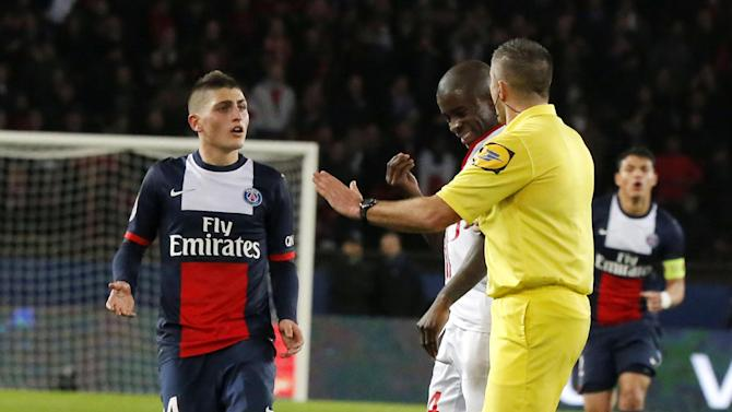 Paris-Saint-Germain's Zlatan Ibrahimovic of Sweden lies on the ground, foreground, while his teammate Marco Verratti of Italy, background left, Lille's Antonio Mavuba, background center, and referee Fredy Gautrel, background right,  gestures as he argues with Mavuba during a French league one soccer match between Paris-Saint-Germain and Lille at Parc des Princes stadium in Paris, Sunday Dec. 22, 2013. Ibrahimovic and Mavubat were booked for shoving each other