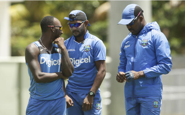 West Indies' Jermaine Blackwood, from left, talks with Veerasammy Permaul, and Darren Bravo, during a practice session in Roseau, Dominica, Tuesday, June 2, 2015. The first cricket Test match betw