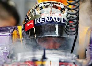 Sebastian Vettel of Germany is sprayed with dried ice to keep cool during the third practice session of the Austin F1 Grand Prix at the Circuit of the Americas in Austin