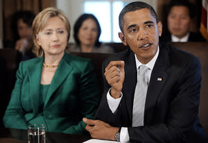 Hillary Clinton, Barack Obama   Photo Credits: Olivier Douliery-Pool/Getty Images