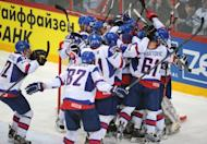 Slovakia's players celebrate their team's victory 3-1 over Czech Republic at the end of their semi-final ice hockey game of the IIHF International Ice Hockey World Championship in Helsinki