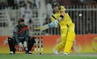 Australian captain Michael Clarke (R) hits a six as Afghanistan's wicketkeeper Mohammad Shehzad looks on during a One Day International cricket match at the Sharjah cricket stadium. Australia beat Afghanistan by 66 runs in the first-ever limited over international between the two countries at Sharjah Stadium