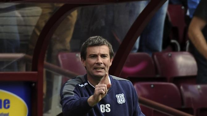 Two early goals saw Barry Smith's Dundee progress