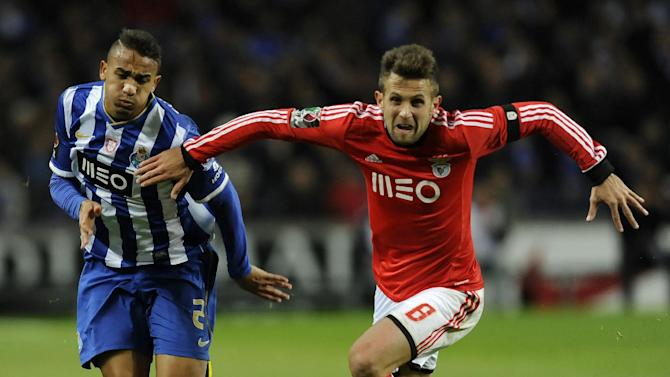 FC Porto's Danilo Silva, left, from Brazil challenges Benfica's Miralem Sulejmani, from Serbia, in a Portugal Cup semifinal first leg soccer match at the Dragao stadium in Porto, Portugal, Wednesday, March 26, 2014. Porto won 1-0