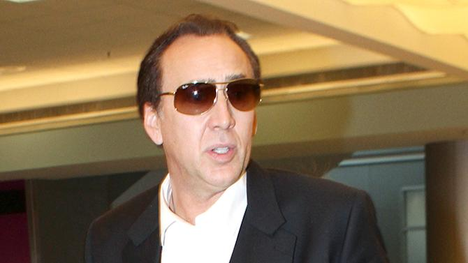 Exclusive - Nicolas Cage and Family At Miami International Airport