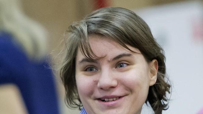"Member of the Pussy Riot punk band Yekaterina Samutsevich smiles as she attends a session at the Moscow City Court where she is appealing to overturn a court's decision to ban the video of the band's ""punk prayer"" in Moscow's main cathedral as ""extremist"", Russia, Thursday, Jan. 24, 2013. Samutsevich was one of the three band members sentenced to two years in jail in August after their performance last February at Moscow's Christ the Savior cathedral. She was later released on appeal.  (AP Photo/Misha Japaridze)"