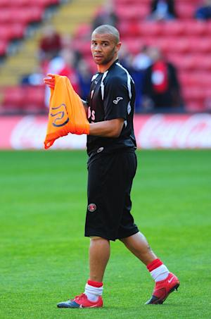 Well-travelled striker Deon Burton is on trial with MK Dons
