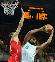 Nigerian forward Ike Diogu shoots during the Men's Preliminary Round Group A basketball match Nigeria vs Tunisia at the London 2012 Olympic Games , July 29, 2012 in London. Nigeria won 60-56