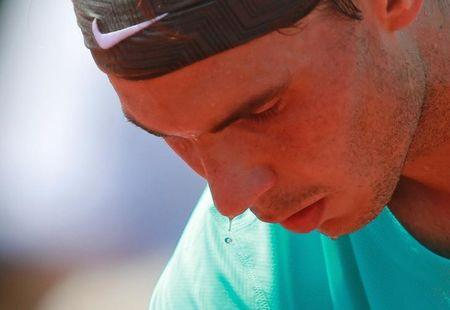 Rafael Nadal of Spain prepares to serve to Novak Djokovic of Serbia during their men's singles final match at the French Open Tennis tournament at the Roland Garros stadium in Paris
