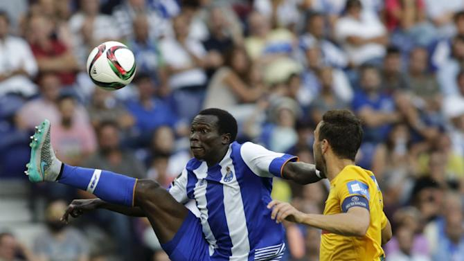 Porto's Aboubakar fights for the ball with Estoril's Tavares during their Portuguese Premier League soccer match at Dragao stadium in Porto