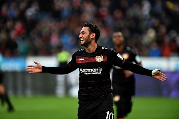 Leverkusen's midfielder Hakan Calhanoglu celebrates during the German first division Bundesliga football match of Bayer Leverkusen vs Hertha BSC Berlin in Leverkusen, western Germany, on January 2