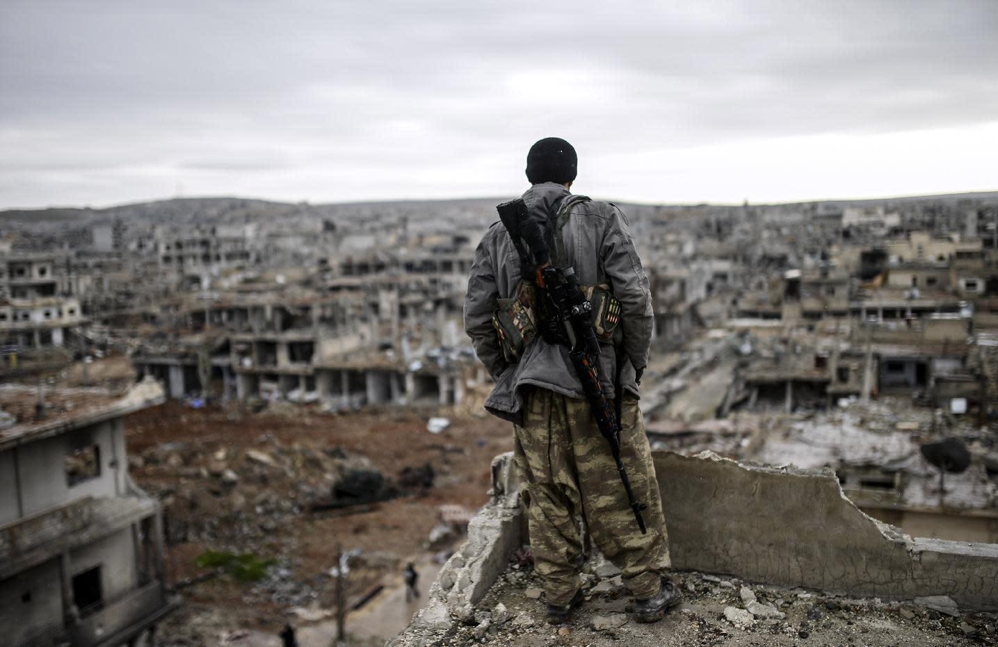 Gritty Kurdish fighter gloats over recapture of Kobane