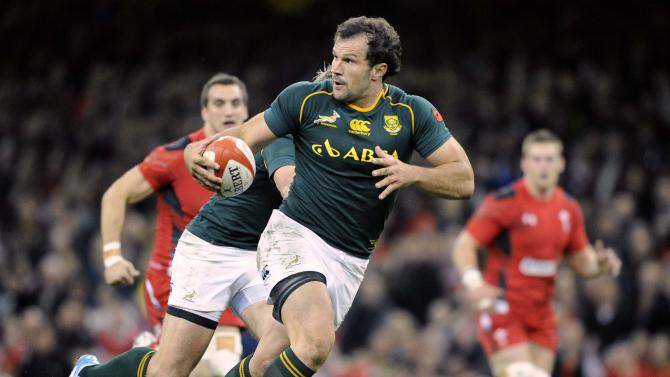 South Africa's Bismarck Du Plessis breaks through the Welsh defence before scoring a try during the international rugby union match at the Millennium Stadium in Cardiff