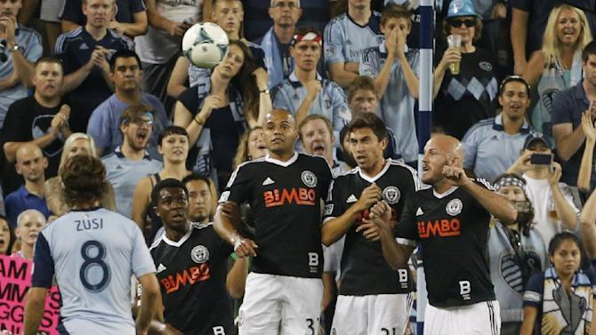 Philadelphia Union midfielder Michael Lahoud (13), defender Fabinho (33), midfielder Michael Farfan (21) and forward Conor Casey (6) try to block a free kick during the first half of an MLS soccer match against Sporting KC in Kansas City, Kan., Friday, Sept. 27, 2013