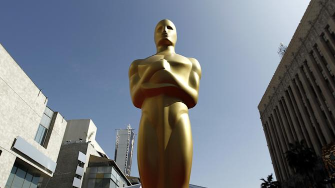 """FILE - In this Feb. 25, 2012 file photo, a Oscar statue is seen on the red carpet before the 84th Academy Awards in Los Angeles. The motion picture academy is honoring employees of film laboratories with an honorary Oscar statuette. The Academy of Motion Pictures Arts and Sciences said Wednesday, Jan. 8, 2014, other Scientific and Technical Awards recipients this year will include visual effects supervisor Peter W. Anderson and executive Charles """"Tad"""" Marburg. Portions of the Scientific and Technical Awards presentations will be included in the Academy Awards broadcast on March 2, 2014. (AP Photo/Matt Sayles, File)"""