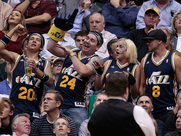 Utah Jazz fans trade fours. (Getty Images)