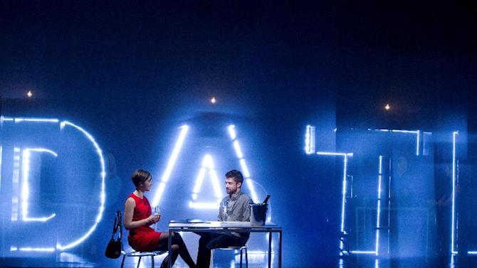 """In this theater image released by The Hartman Group, Olivia Thirlby, left, and Topher Grace are shown during a performance of """"Lonely I'm Not,"""" in New York. (AP Photo/The Hartman Group, Joan Marcus)"""