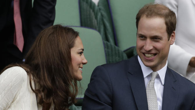Britain's Prince William, right, and Kate, Duchess of Cambridge watch Roger Federer of Switzerland play Mikhail Youzhny of Russia during a quarterfinals match at the All England Lawn Tennis Championships at Wimbledon, England, Wednesday July 4, 2012. (AP Photo/Anja Niedringhaus)