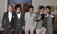 One Direction pose on the red carpet arriving at the BRIT Awards 2012 in London on February 21, 2012