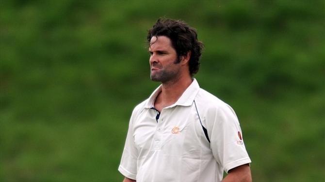Cricket - Former NZ captain Cairns charged with perjury