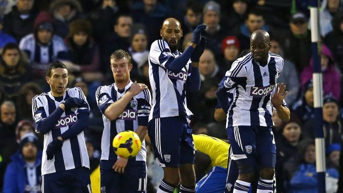West Bromwich Albion players Amalfitano, Brunt, Anelka and Mulumbu form a wall for a Newcastle United free kick during their English Premier League soccer match in West Bromwich