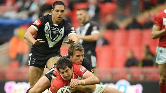 Danny Jones (front) being tackled by New Zealand's Kieran Foran during the Gillette Four Nations match at Wembley Stadium, London, on November 5, 2011. The welsh international rugby league player died after suffering a suspected cardiac arrest during a match.