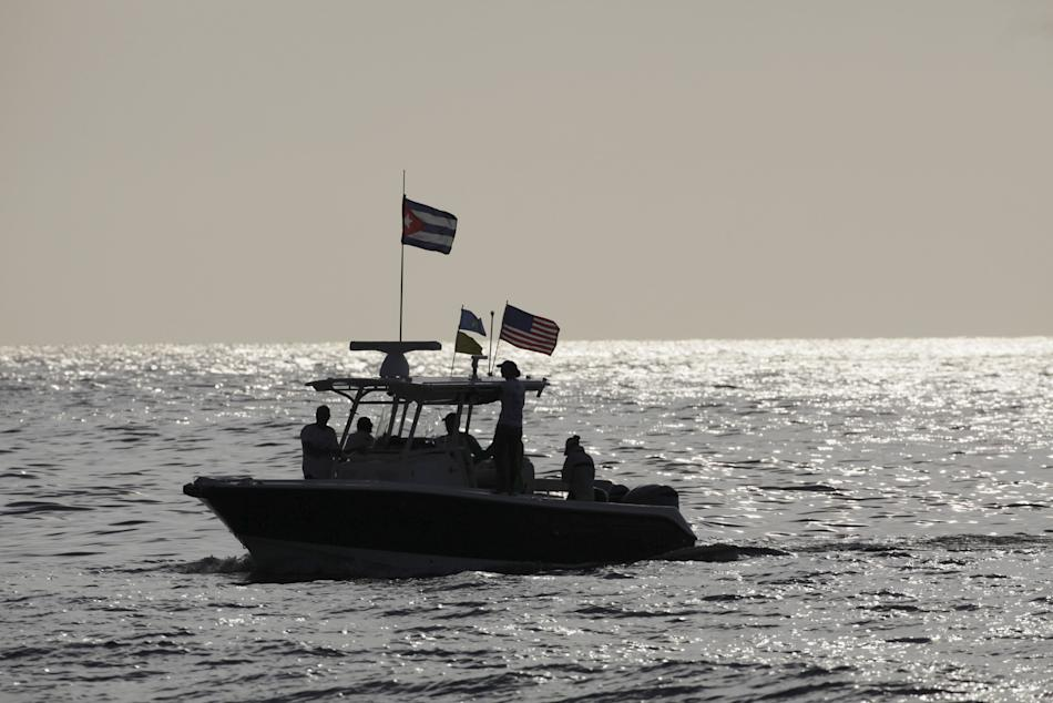 An U.S. support boat with Cuban and U.S. flags arrives to Marina Hemingway during the Havana challenge race