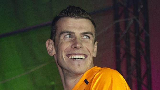 Real Madrid player Gareth Bale takes part in a soccer boot promotional event in Madrid, Spain. Thursday Nov. 21, 2013