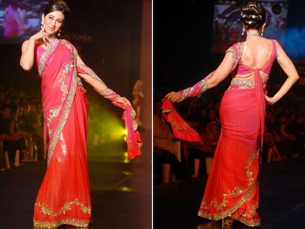 Images via : iDiva.comKarisma Kapoor looks so retro in this backless sari blouse, hairdo and make up. We like the tie-up, but the sari is ho-hum.Related Articles - Celeb Trend: Sexy Net SarisVote: Hot