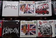 T-shirts commemorating Queen Elizabeth II's diamond jubilee are on sale in a London shop. Just a year after the wedding of Prince William and Kate Middleton, royal fever is sweeping the British high street once again