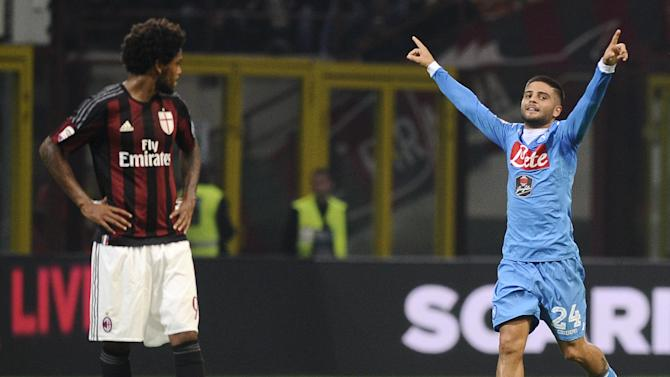 Napoli's Insigne celebrates after scoring a goal as AC Milan's Adriano looks on during their Italian Serie A soccer match at the San Siro stadium in Milan