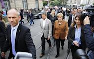 German Chancellor and leader of Christian Democratic Union (CDU) Angela Merkel and her husband Joachim Sauer arrive to vote in the German general election (Bundestagswahl) at a polling station in Berlin, September 22, 2013. REUTERS/Thomas Peter
