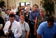 Current and former military personnel stand in line while checking in at the Opportunity Job Fair on September 6 in San Diego, California. A glum US jobs market report for August on Friday was bad news for President Barack Obama's reelection fight but raised the likelihood that the Federal Reserve will take fresh action to boost the economy