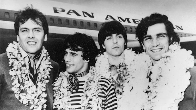 """FILE - This Feb. 26, 1968 file image shows, from left,  Gene Cornish, Eddie Brigati, Dino Danelli and Felix Cavaliere from the American rock group The Rascals at JFK Airport in New York, after a trip to Hawaii. The group, gave us """"Good Lovin,'"""" """"People Got To Be Free"""" and """"I've Been Lonely Too Long"""" are grooving their way to Broadway. Performances of """"The Rascals: Once Upon a Dream"""" will begin April 15 at the Richard Rodgers Theatre for 15 shows, ending May 5.  (AP Photo, file)"""